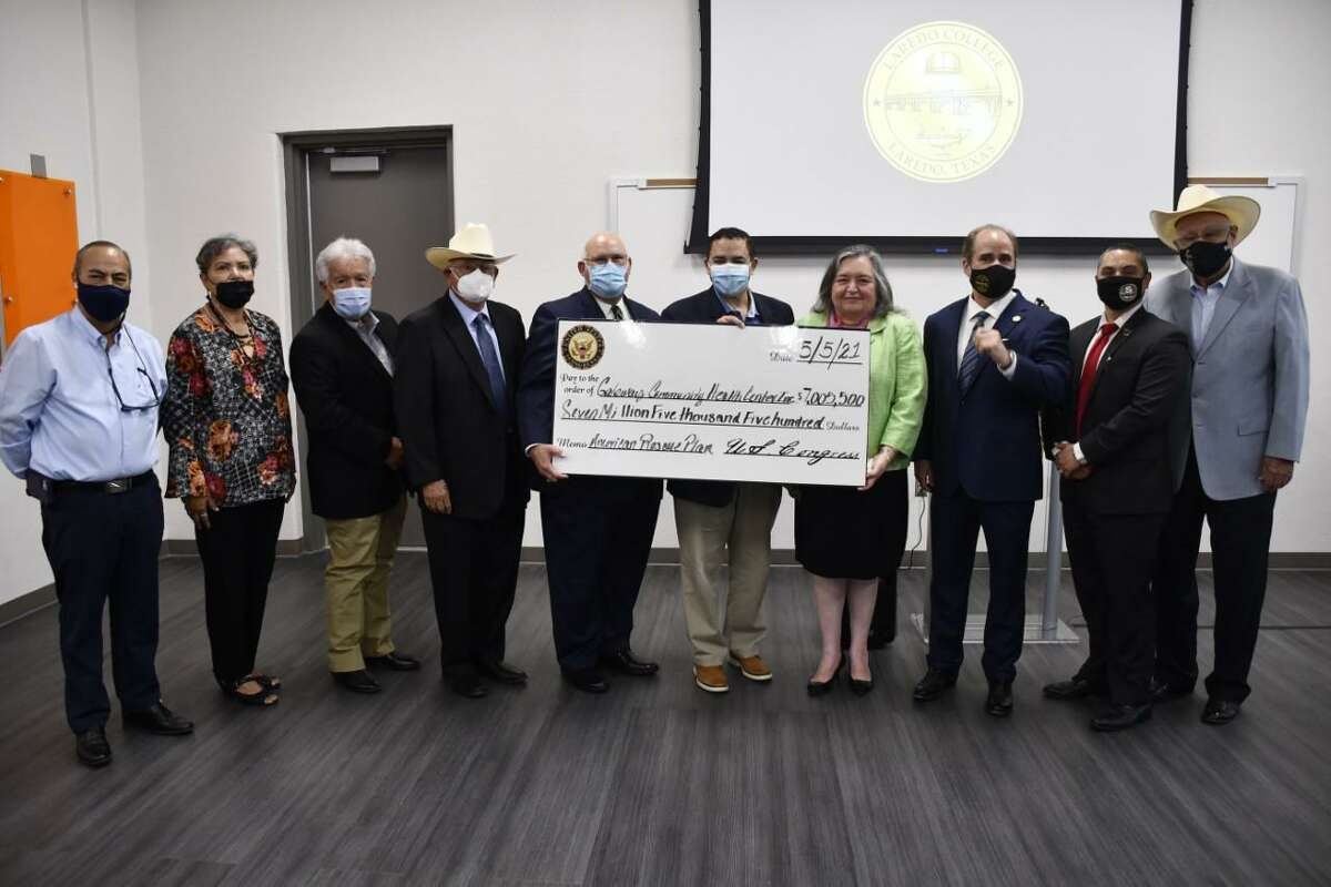 Representatives from Gateway Community Health Center and Laredo College pose with Rep. Henry Cuellar and a $7 million check from the American Rescue Plan.