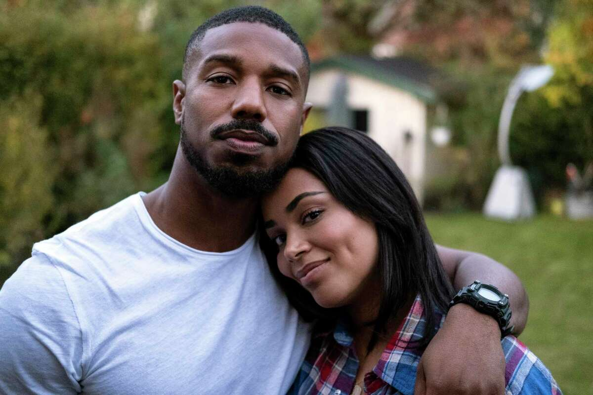 """This image released by Amazon shows Michael B. Jordan, left, with Lauren London in """"Tom Clancy's Without Remorse,"""" streaming Friday on Amazon."""