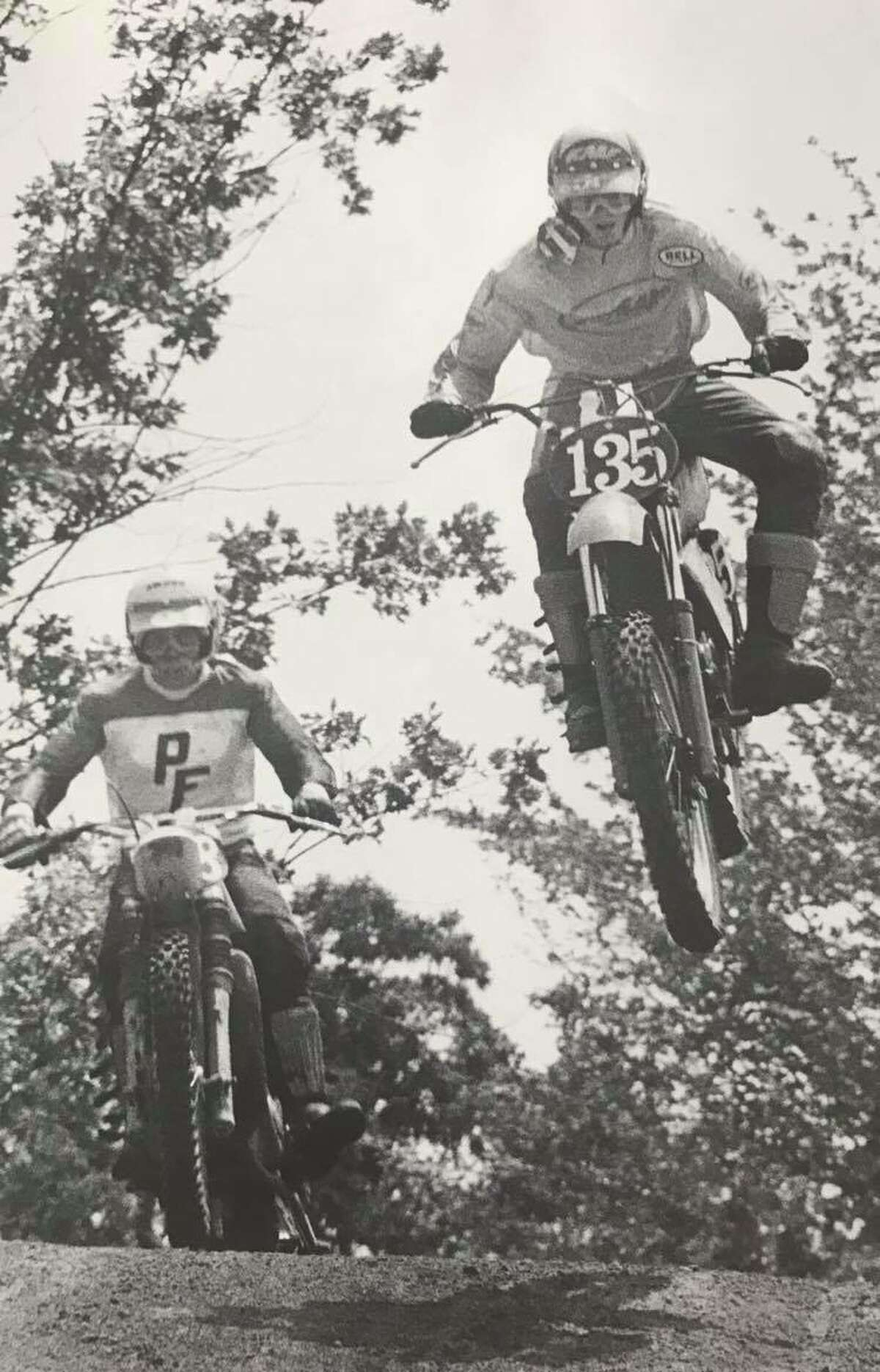 Randy Hess, right, and another rider go through a practice run at the Polka Dots Motorcycle Club track. June 1977