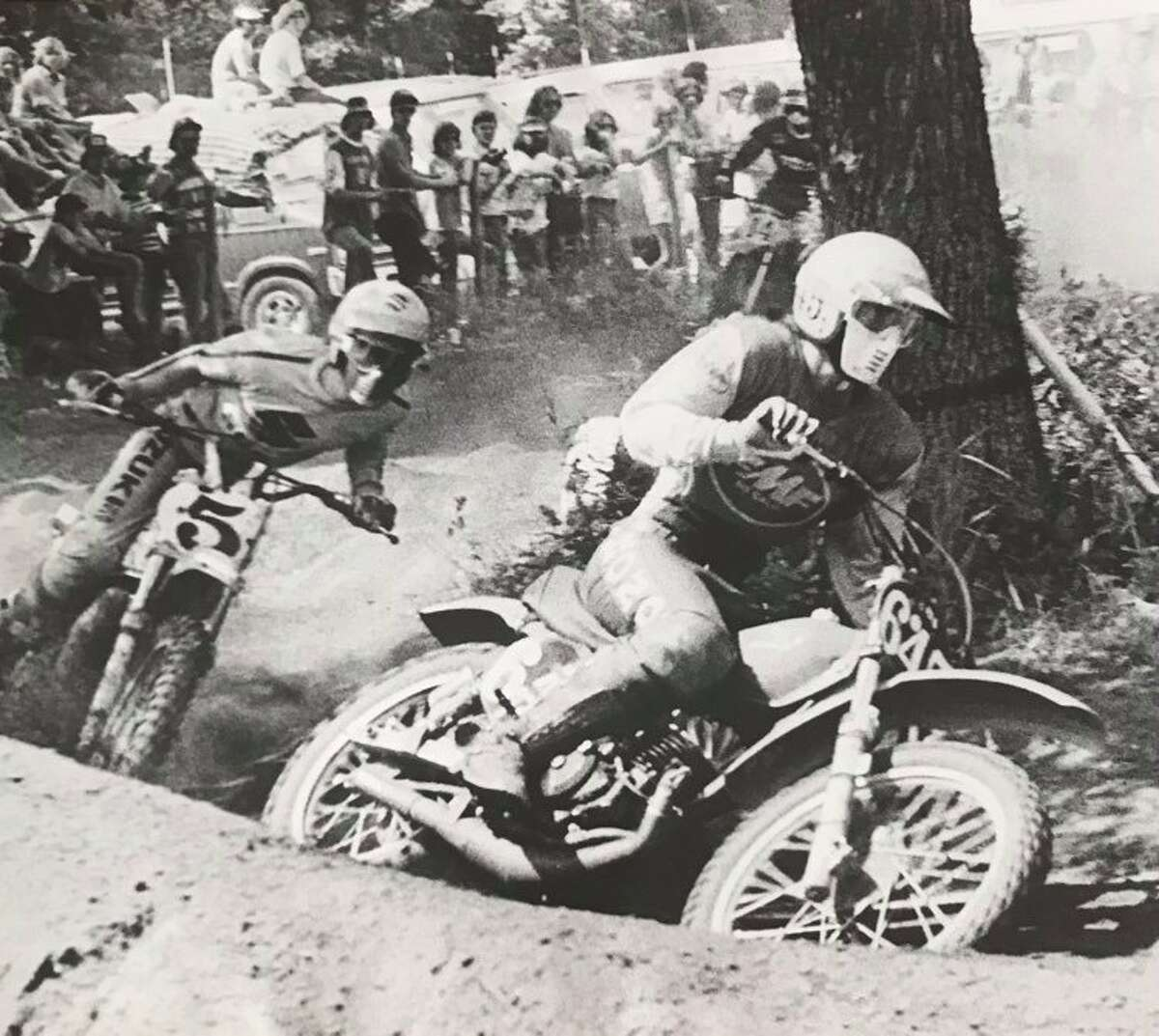 Motocross riders round a curve at the 125cc national event at the Polka Dots Motorcycle Club track. June 1976