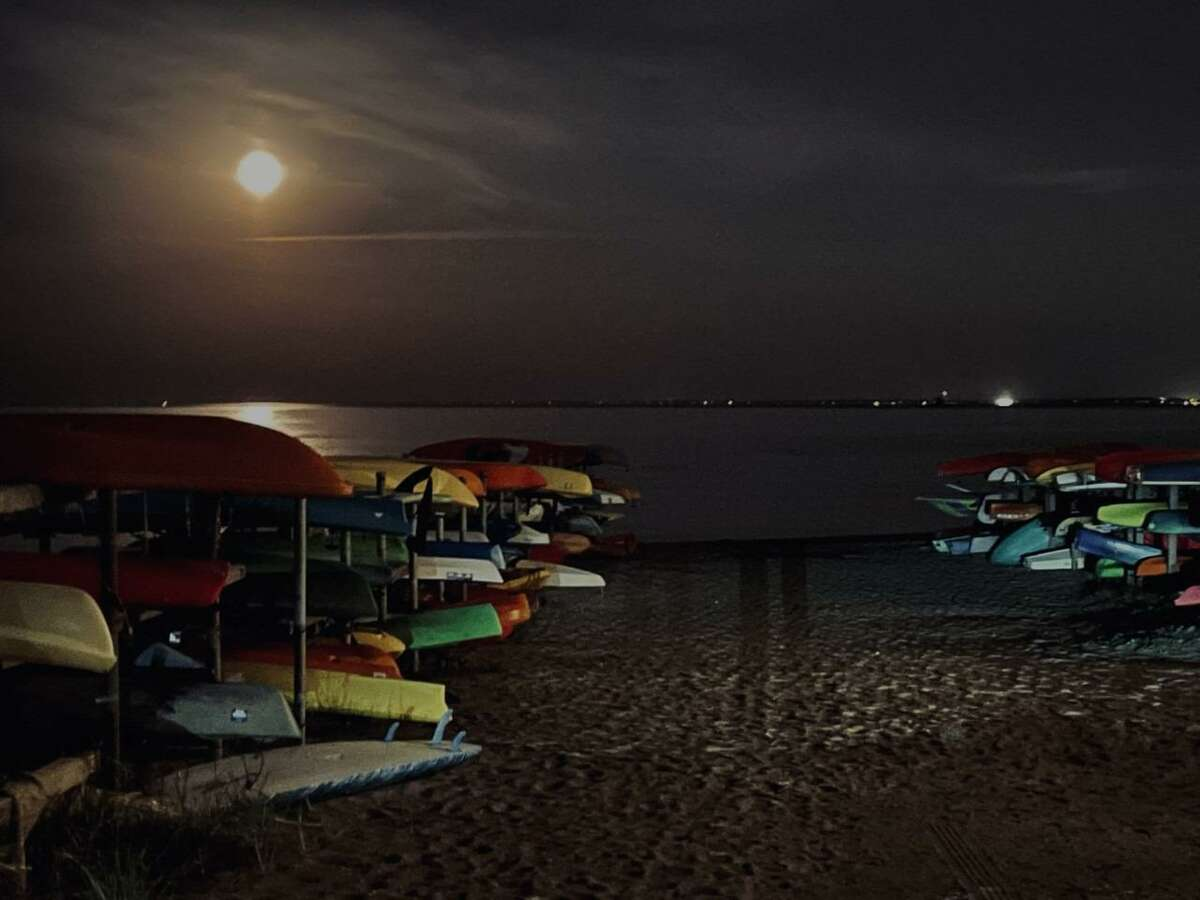 Donald Hyman, a Fairfield resident, took this photo Monday, April 26, at 9:30 p.m., at the Penfield Beach kayak racks in Fairfield. The kayak rack were illuminated by the pink super moon, which was visible in the sky that night.