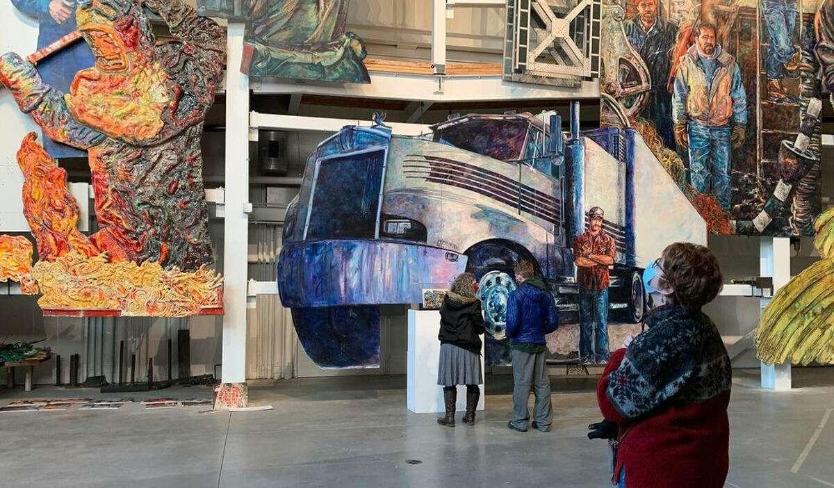 On guided tours, visitors learn about the American Mural Project's tribute to American workers.