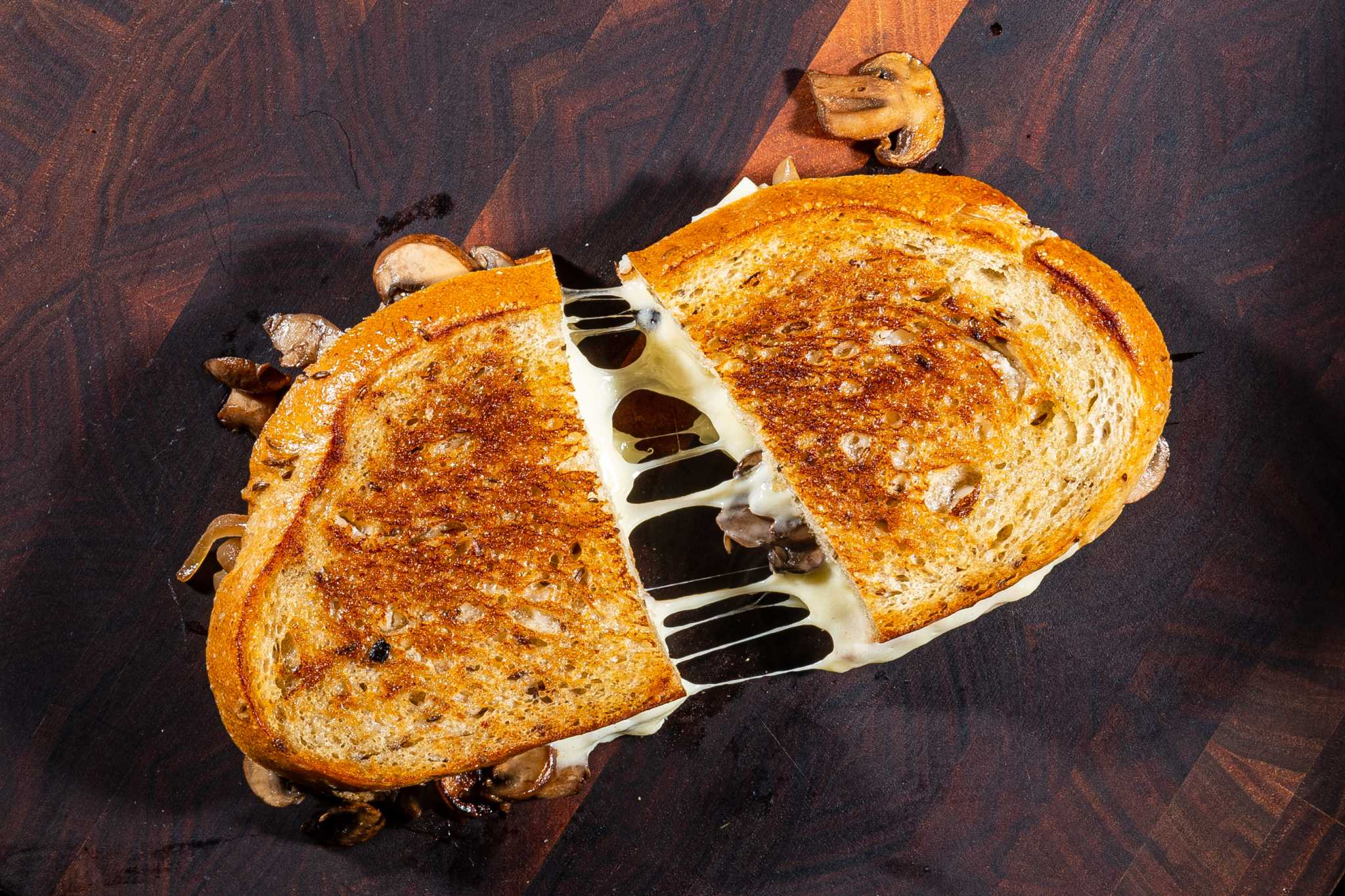 This diner-style 'patty' melt is full of caramelized onions, mushrooms and cheese