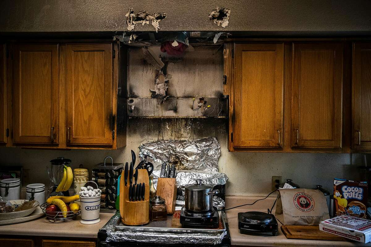 The damage after a fire in Thomas' kitchen two years ago and a window broken years ago have never been repaired, despite repeated requests.