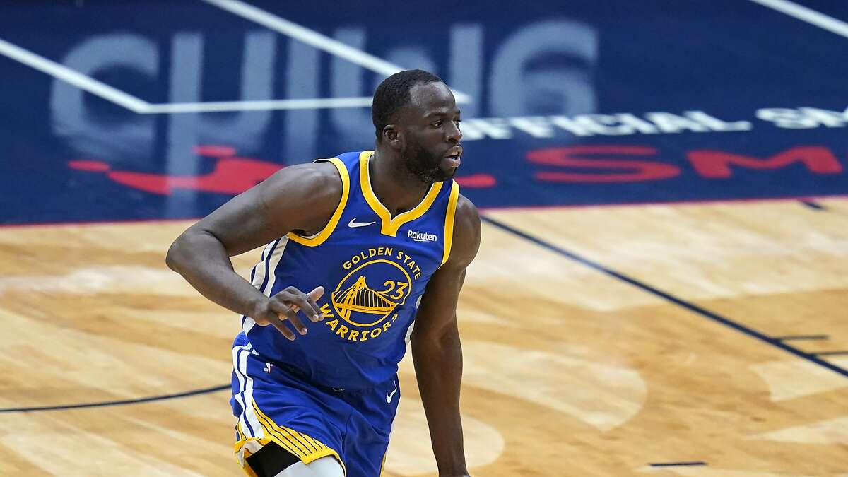 Golden State Warriors forward Draymond Green (23) moves the ball up court in the first half of an NBA basketball game against the New Orleans Pelicans in New Orleans, Tuesday, May 4, 2021. (AP Photo/Gerald Herbert)