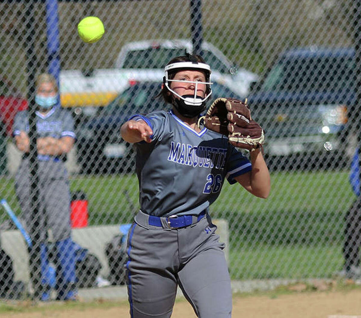Marquette Catholic pitcher Lauren Lenihan, shown throwing out baserunner in a game earlier this season in Alton, struck out 13 Wednesday in a complete-game win at Gillespie that ended the Miners' seven-game winning streak.