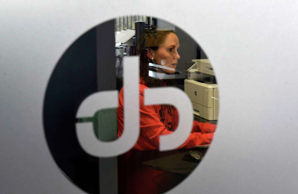 Human resources personnel Dani Milliken sits in her office at Jahnel Group on Friday, April 16, 2021 in Schenectady, N.Y.(Lori Van Buren/Times Union)