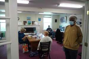 The clubhouse at Prime Time House is run by members and staff. Above, a group in the community resource center at 836 Main St., Torrington.