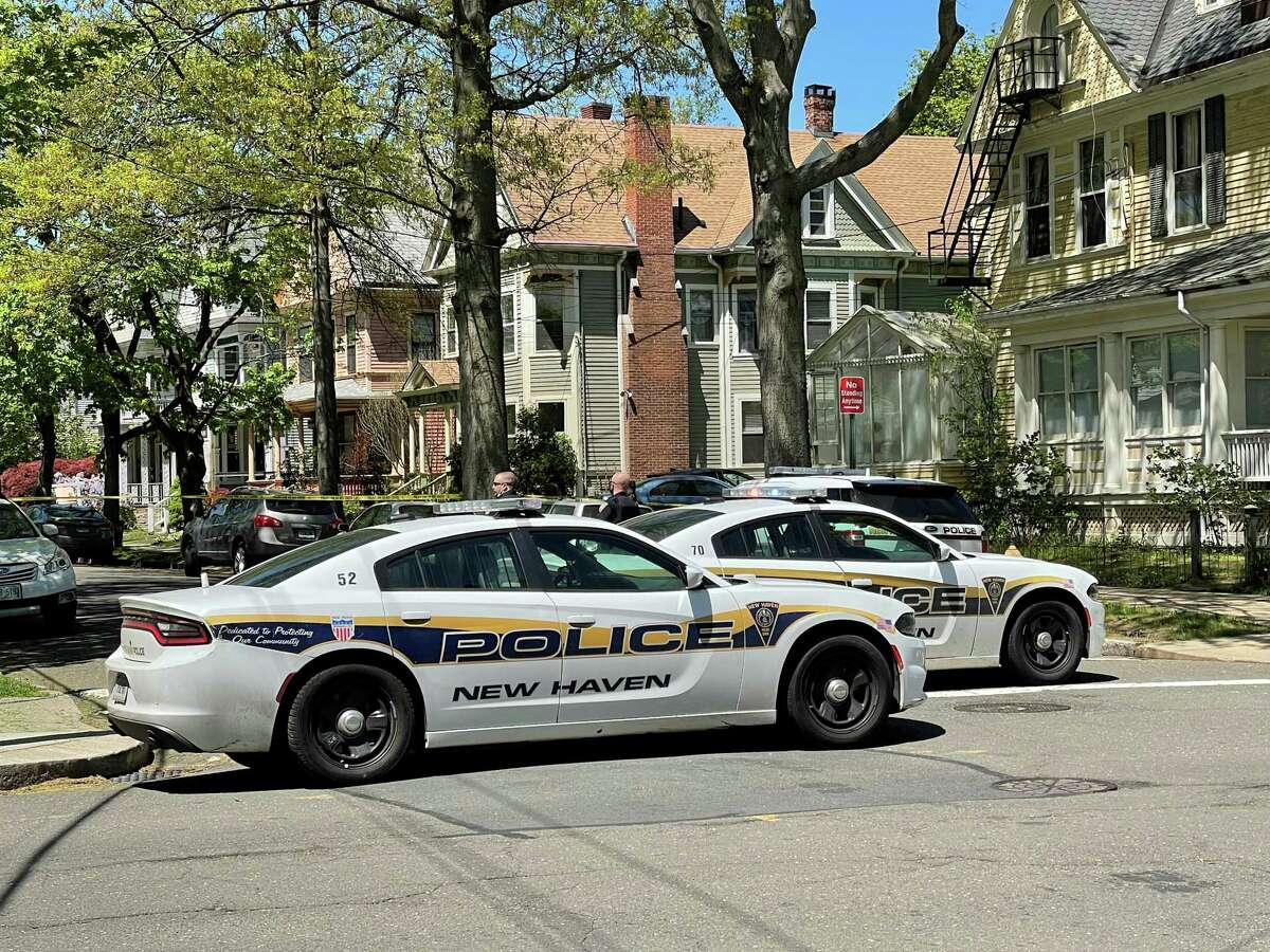 Police block off Livingston Street in New Haven, Conn., on Thursday, May 6, 2021, after a person barricaded himself.