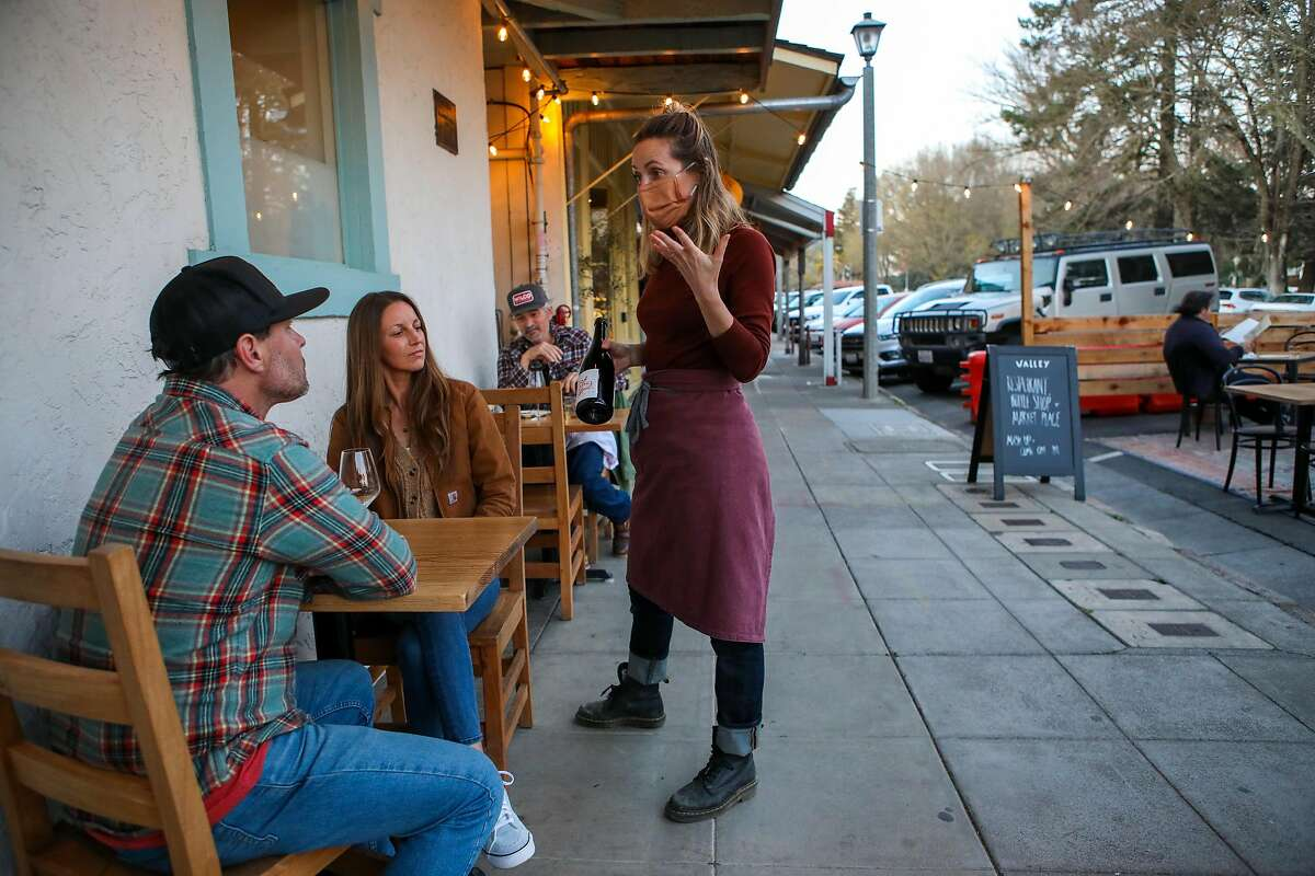 Co-partner Lauren Feldman converses with guests Jenny Schultz and husband Scott Schultz, owners of Jolie-Laide Wines, at Valley Bar & Bottle in Sonoma.