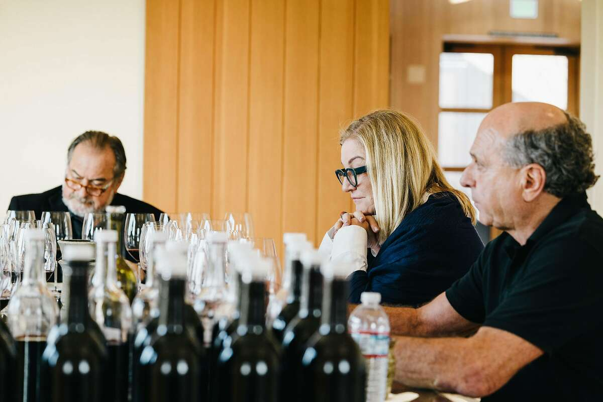 Suzanne Deal Booth tastes Bella Oaks Vineyard wines, flanked by wine consultant Michel Rolland (left) and viticulturist David Abreu.