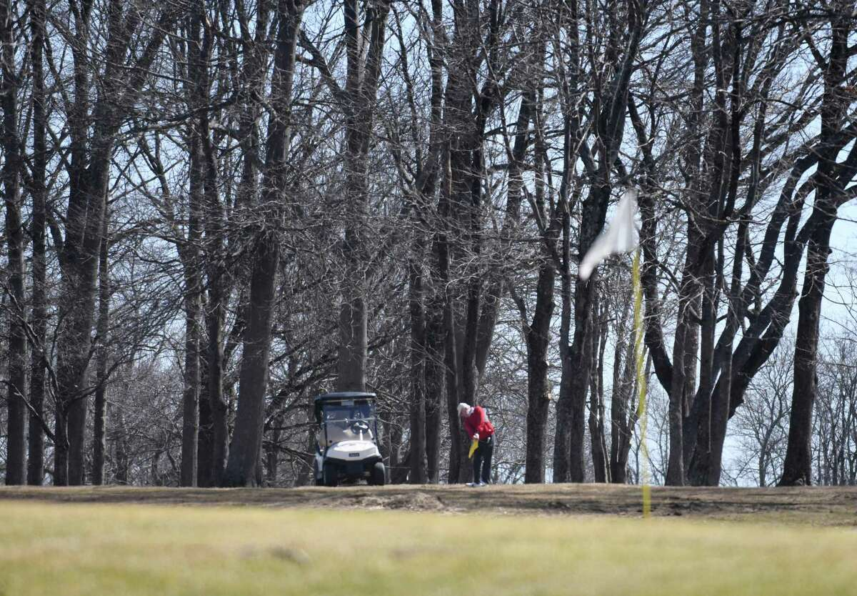 Cos Cob's Frank DiVincenzo hits a shot on the opening day at Griffith E. Harris Golf Course in Greenwich, Conn.