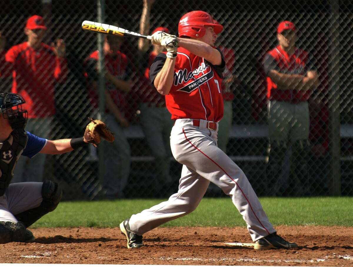 Masuk's Tom Milone hits the ball during boys baseball action against Newtown in Monroe, Conn. on Wednesday May 11, 2011.