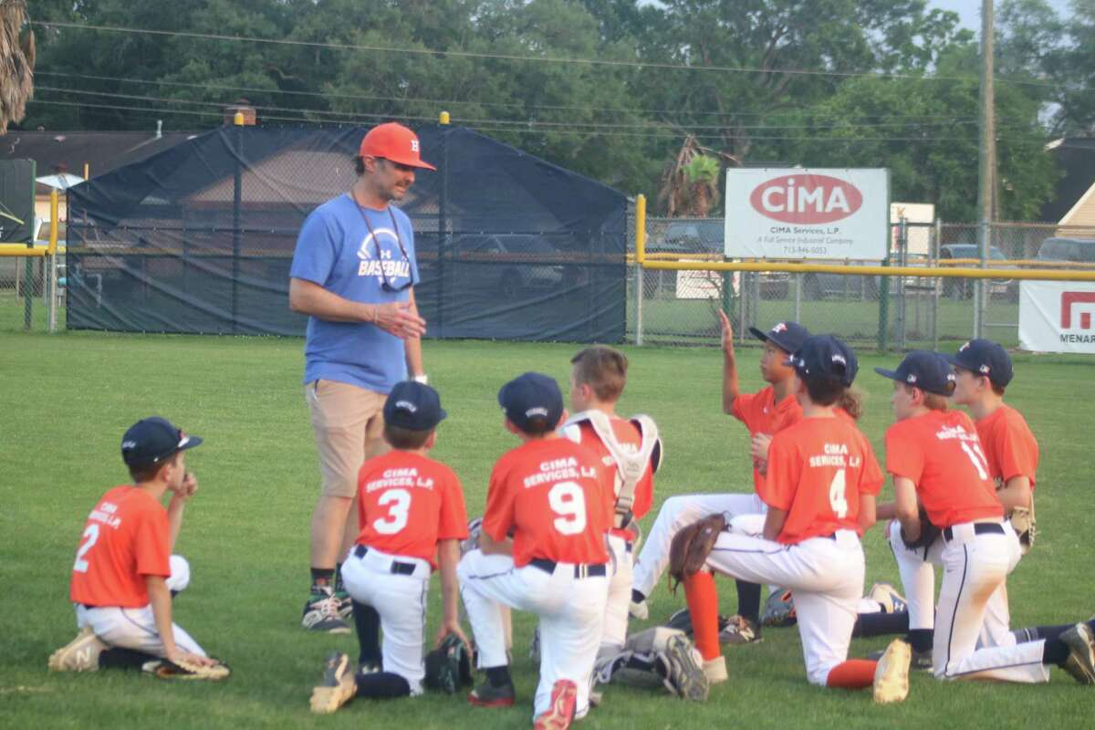 John Bailey, the former Texans player who belted two home runs his senior year, holds a postgame meeting with the Astros players Tuesday night, following the team's 14-2 win. After a slow start, the Astros have been coming on, even defeating the first-place Red Sox.