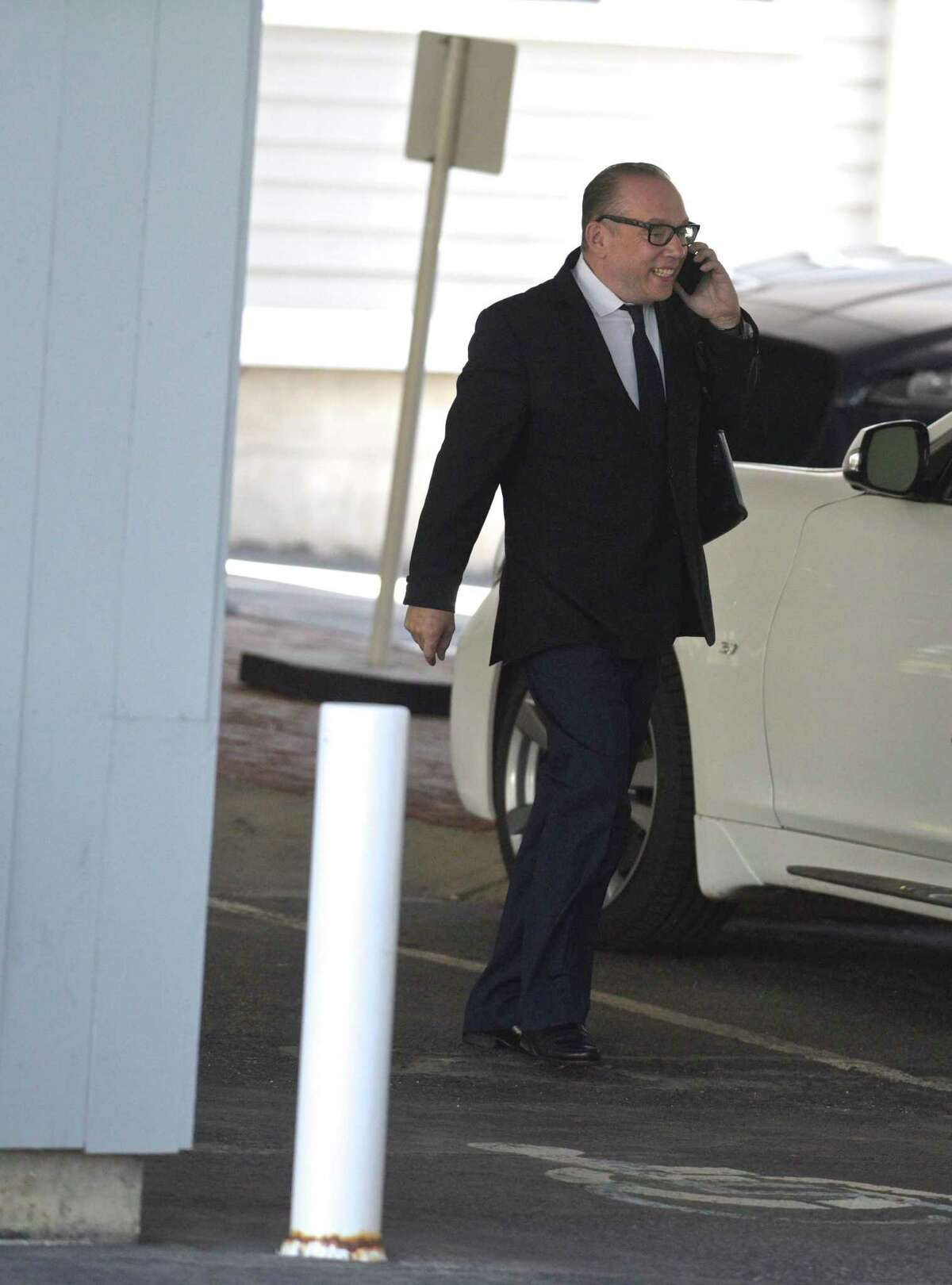 Bruno DiFabio, a celebrity chef and TV personality, leaves his attorney's Southport office after being sentenced to 30 days in prison on a federal tax evasion charge during a virtual hearing on Thursday.