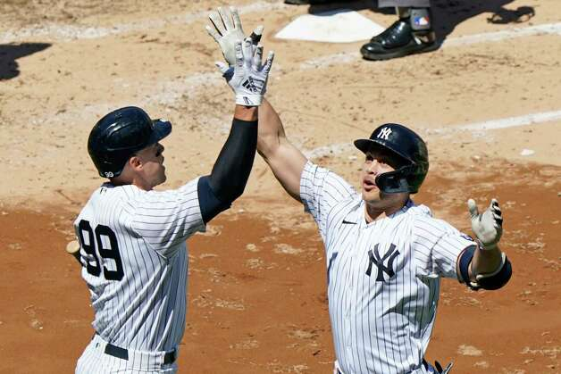 On-deck batter New York Yankees' Aaron Judge, left, celebrates with the Yankees designated hitter Giancarlo Stanton after Stanton hit a solo home run during the third inning of a baseball game against the Houston Astros, Thursday, May 6, 2021, at Yankee Stadium in New York. (AP Photo/Kathy Willens) Photo: Kathy Willens, Associated Press / Copyright 2021 The Associated Press. All rights reserved.