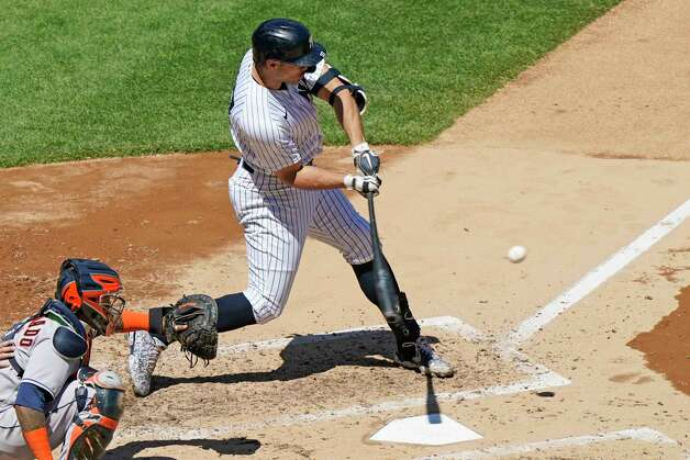 New York Yankees designated hitter Giancarlo Stanton (27) hits a solo home run during the third inning of a baseball game against the Houston Astros, Thursday, May 6, 2021, at Yankee Stadium in New York. Astros catcher Martin Maldonado (15) works behind the plate. (AP Photo/Kathy Willens) Photo: Kathy Willens, Associated Press / Copyright 2021 The Associated Press. All rights reserved.