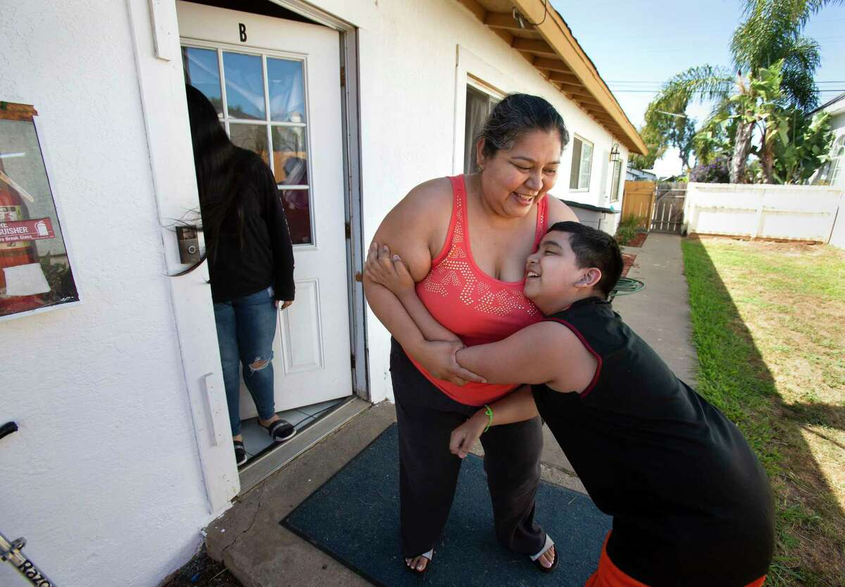 Patricia Mendoza plays with her son outside their apartment in Imperial Beach, Calif., on April 25, 2021,