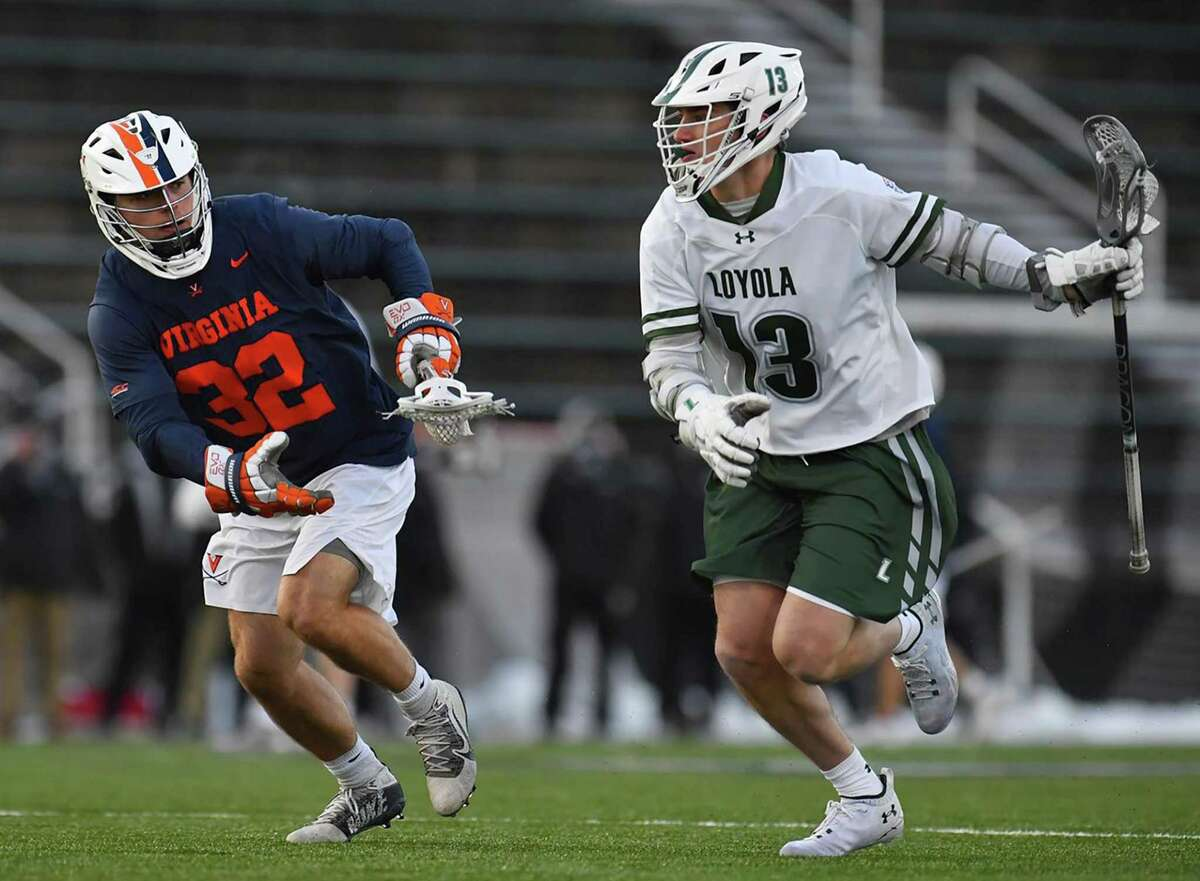 New Canaan's Peter Swindell (13) of the Loyola-Maryland men's lacrosse team in action against Virginia during a game on Feb. 20.