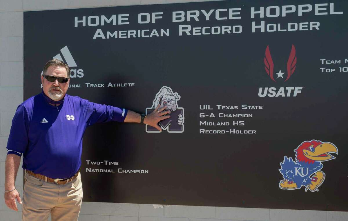 Midland High track coach Jeff Streun talks about Bryce Hoppel's accomplishments 05/06/2021 during the tribute plaque ceremony at Memorial Stadium. Bryce Hoppel is currently training at the University of Kansas. Tim Fischer/Reporter-Telegram
