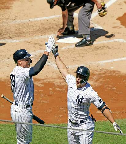 On-deck batter New York Yankees Aaron Judge, left, celebrates with Yankees designated hitter Giancarlo Stanton after Stanton hit a solo home run during the third inning of a baseball game against the Houston Astros, Thursday, May 6, 2021, at Yankee Stadium in New York. (AP Photo/Kathy Willens) Photo: Kathy Willens, Associated Press / Copyright 2021 The Associated Press. All rights reserved.