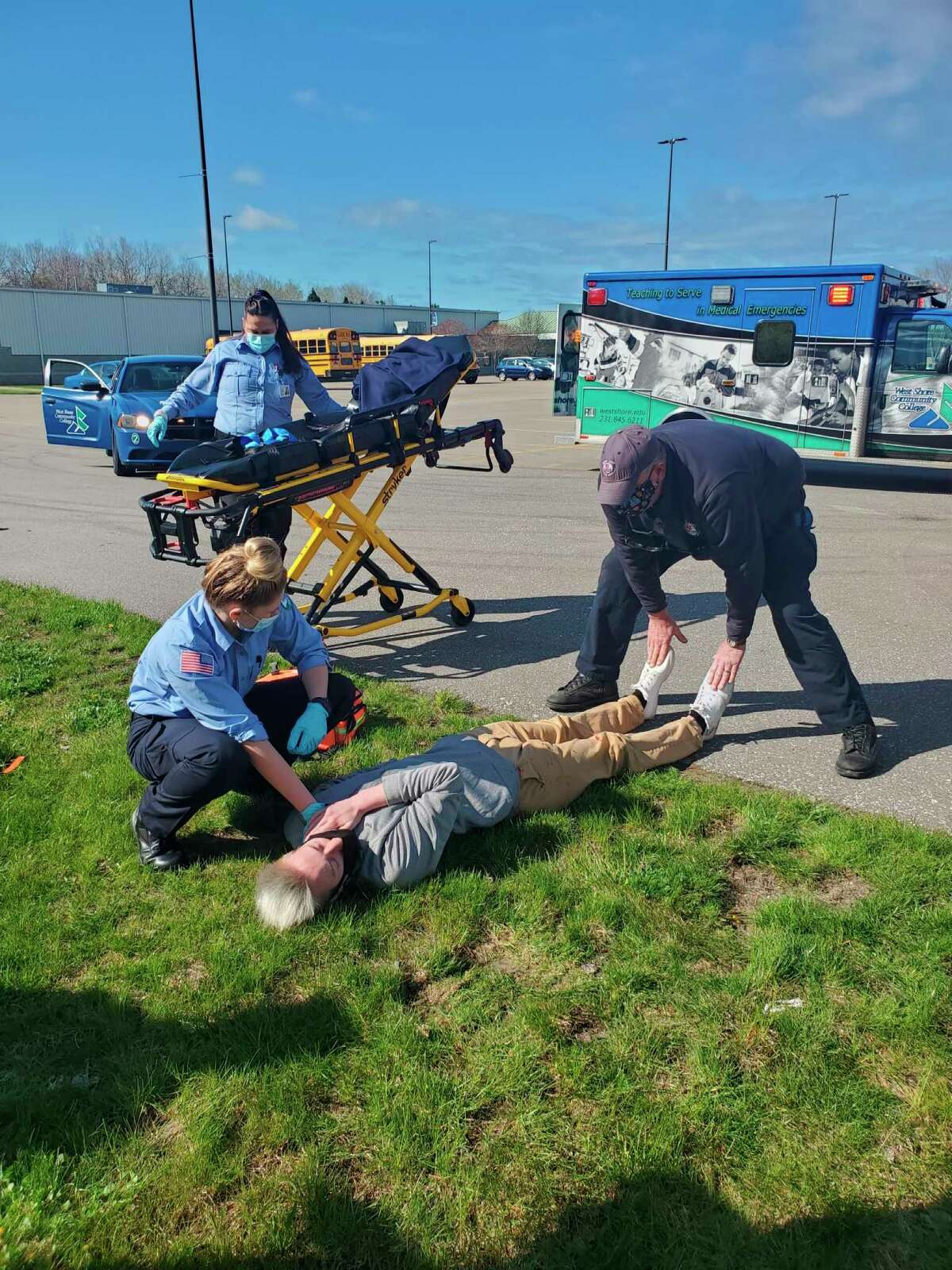 West Shore Community College EMT students Jordyn Wittlieff and Natacha Robertson assist an accident victim, CTE Allied Health student Zachary Lee from Manistee, as instructor Jim Petrie gives input during a day of emergency training scenarios on Friday. (Courtesy photo)