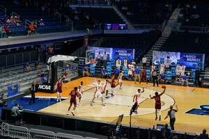 Michigan residents bet a collective $115 million online on NCAA's March Madness tournament. (AP Photo/Michael Conroy)