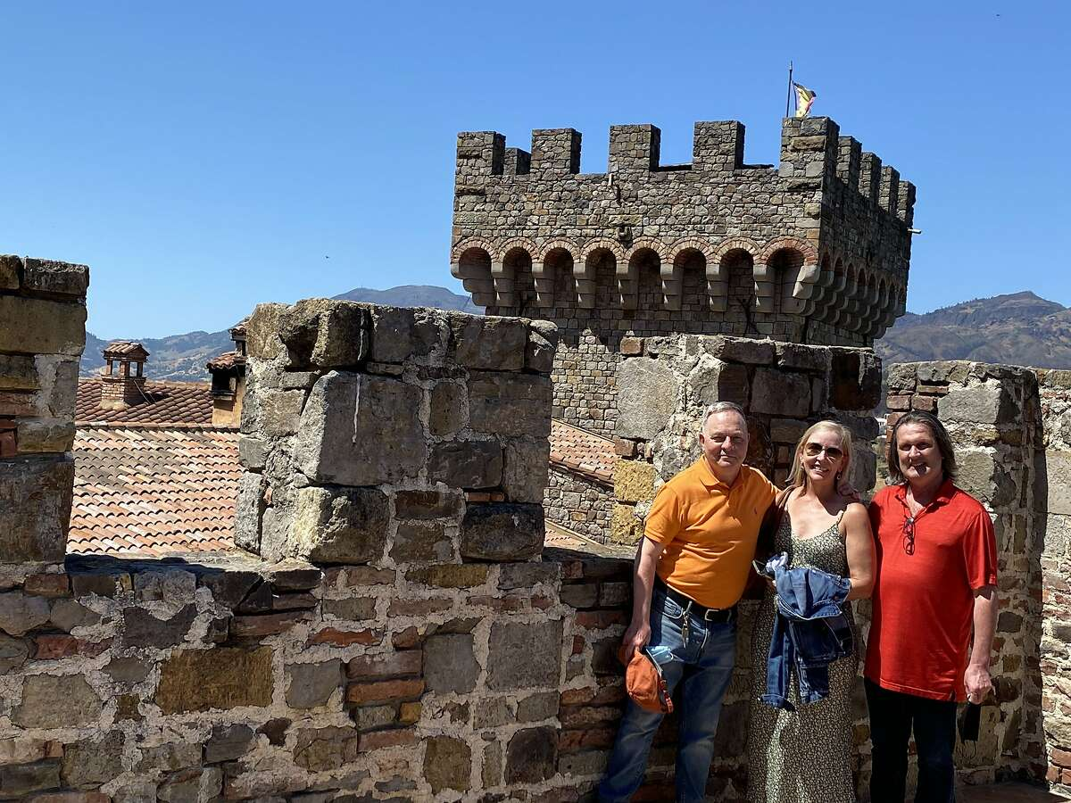 Kevin Fisher-Paulson (left), Stephanie Ann Schrandt Boone and Brian Fisher-Paulson at Castello di Amorosa in Calistoga.