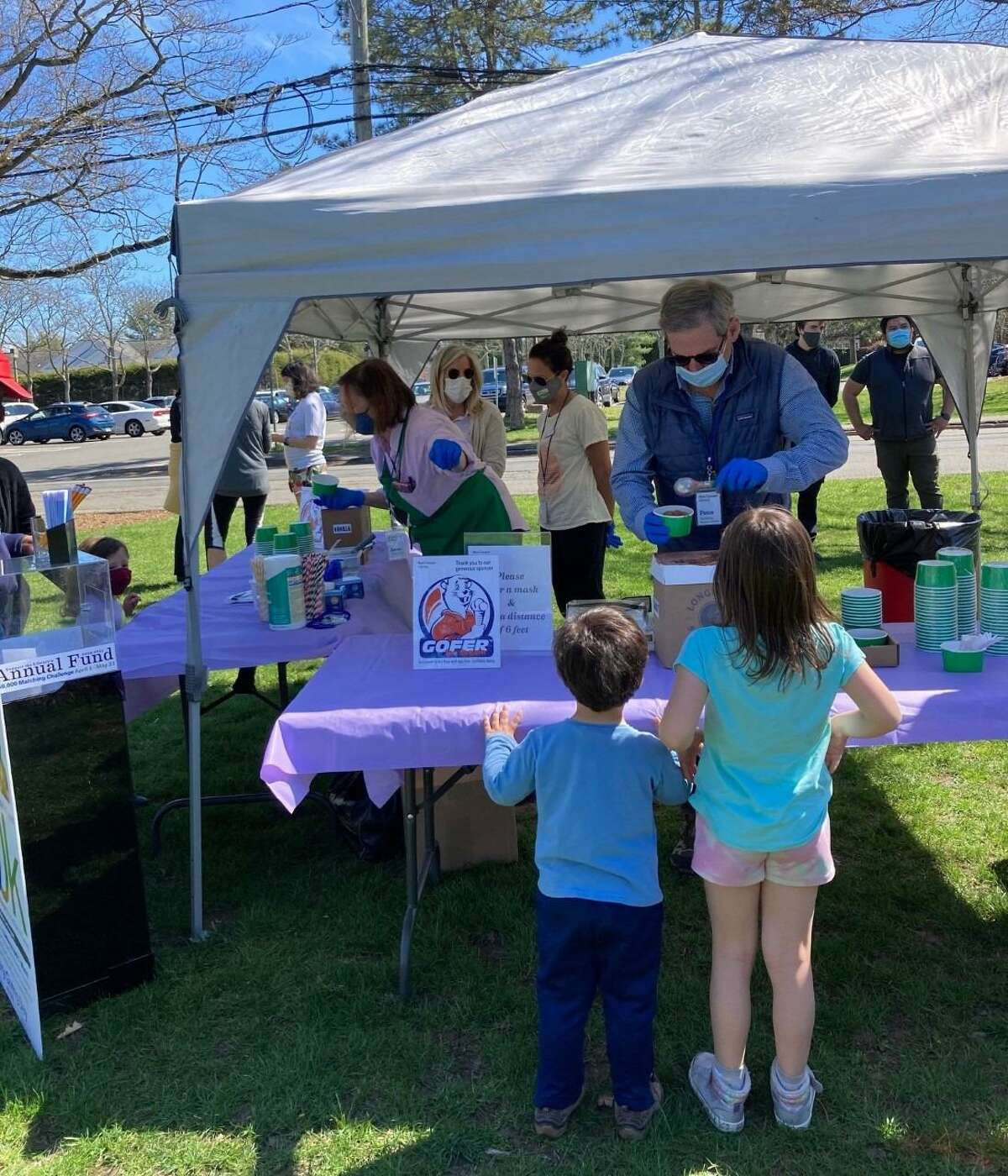 National Library Giving Day. April 7, included a fun ice cream social to give back to the community. New Canaan Board of Trustees Member Peter Zeising scooped up the treats for kids, and their families. Ice cream was generously donated by Gofer Ice Cream.