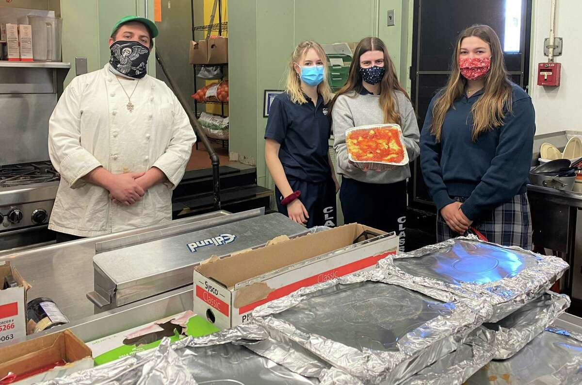Mercy High School students in Middletown recently helped out the St. Vincent de Paul Soup Kitchen by preparing lasagna for its clients. In all, 24 volunteers prepared 35 trays.