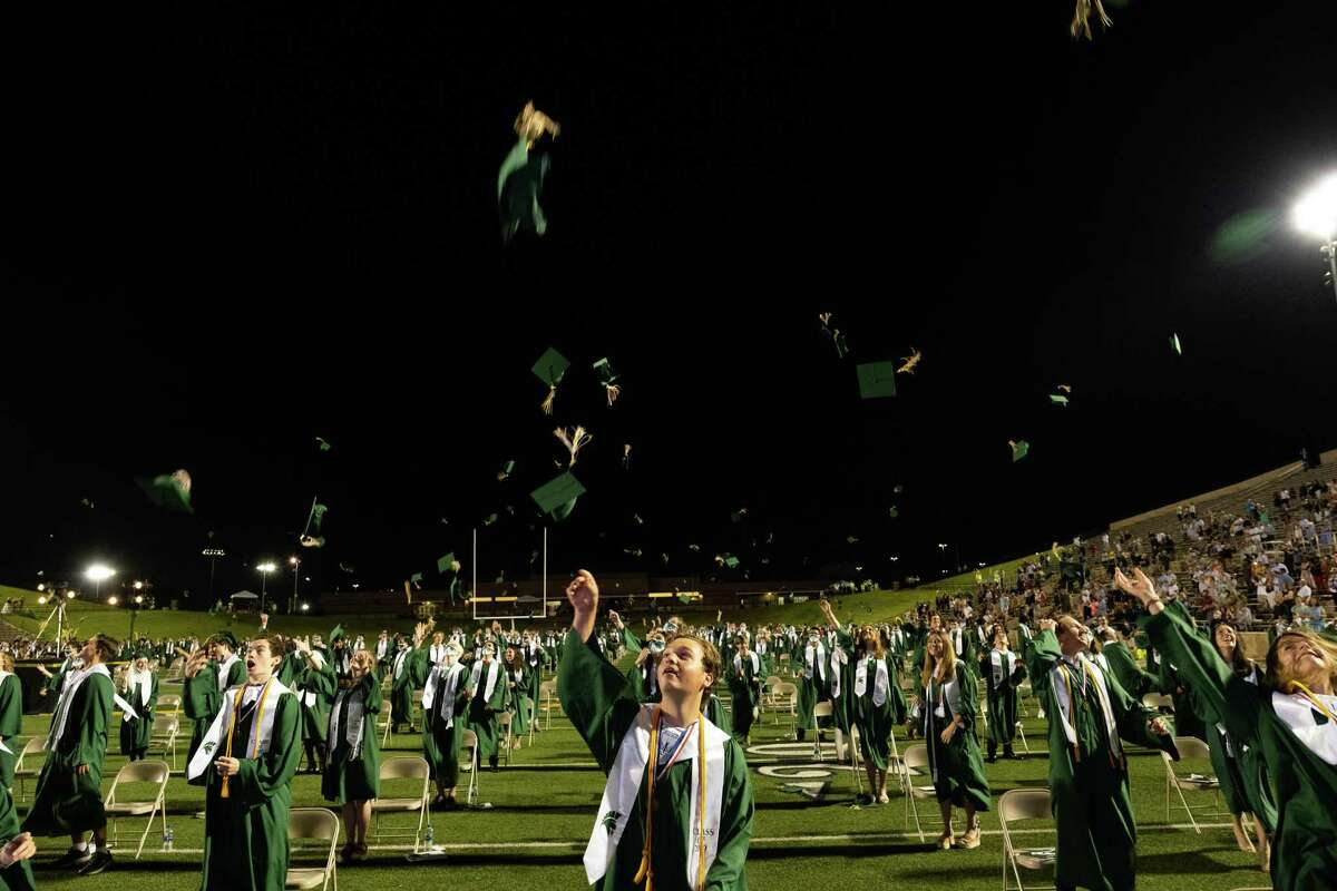 Stratford High School's new graduates from the class of 2020 throw their caps in the air at the conclusion of the graduation ceremony at Darrell Tully Stadium on June 3