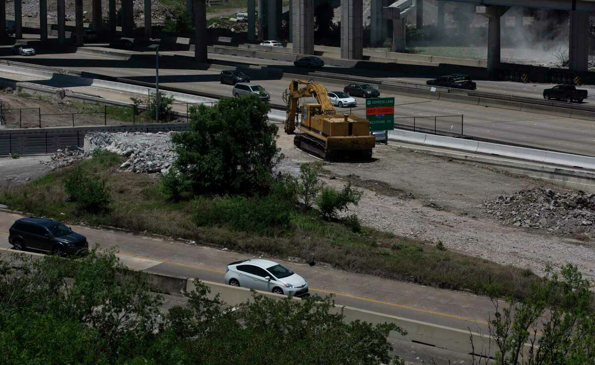 Traffic passes construction equipment on the ramp connecting Loop 610 to Interstate 69 northbound on May 6, 2021, in Houston. Crews will close I-69 northbound at Loop 610 at 9 p.m. Friday, according to the Texas Department of Transportation and the lanes will reopen by 5 a.m. Monday. The closing is needed to reconfigure the northbound lanes as workers prep to build the columns that will support new ramps for the interchange.