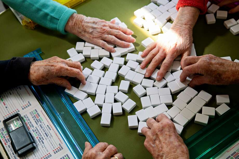 Marjorie Mann plays mah-jongg with longtime friends at Kathleen Branchaud's home in Alameda in March. Photo: Jessica Christian / The Chronicle