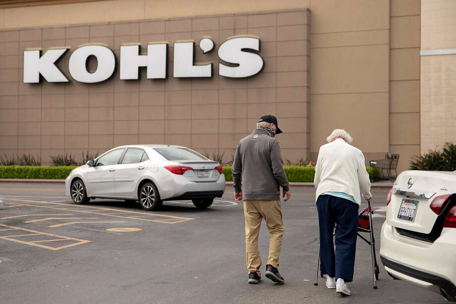 David Mann walks with his mother, Marjorie Mann, 94, to Kohl's in Alameda in April during their first official shopping trip after both were fully vaccinated. Photo: Jessica Christian / The Chronicle