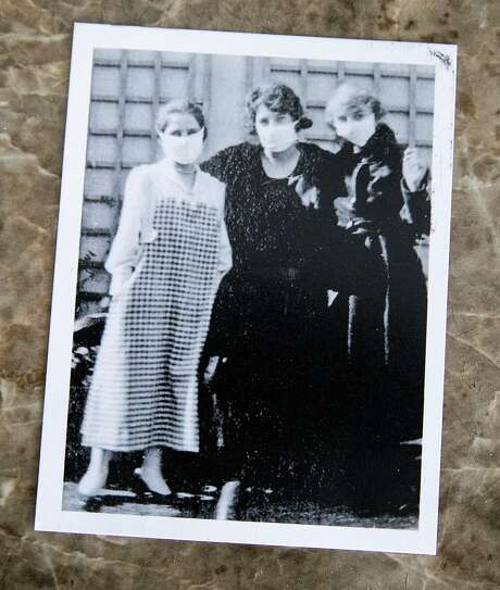 A postcard given to Marjorie Mann shows her aunt Hattie Harder (left) with friends Emily Krumholz (center) and Beth Krumholz in San Francisco during the 1918 Spanish flu epidemic. Photo: Jessica Christian / The Chronicle