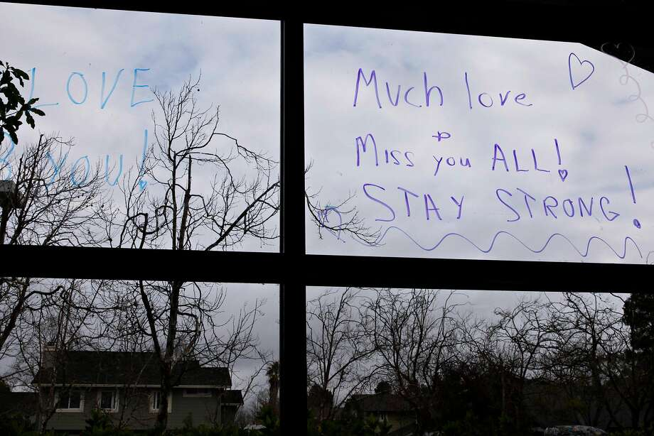 A note on the window at Waters Edge Lodge in February expresses hope as the threat of COVID-19 locks down facilities across the country. Photo: Jessica Christian / The Chronicle
