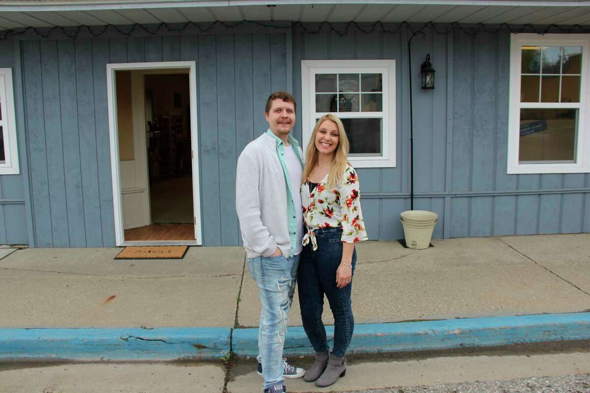 Bryan Logsdon and Allyson Kruse pose for a photos outside of what will eventually become Vibe Up! in Elkton. The two hope this will be the first of other Vibe! Up stores in Huron County. (Robert Creenan/Huron Daily Tribune)