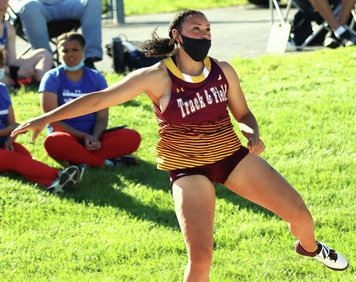 EA-WR senior Jayden Ulrich watches her school- and meet-record throw of 50 feet, 2 inches in the shot put on Wednesday at the Triad Invitational girls track meet in Troy. It was the fourth longest toss in the shot in state history.
