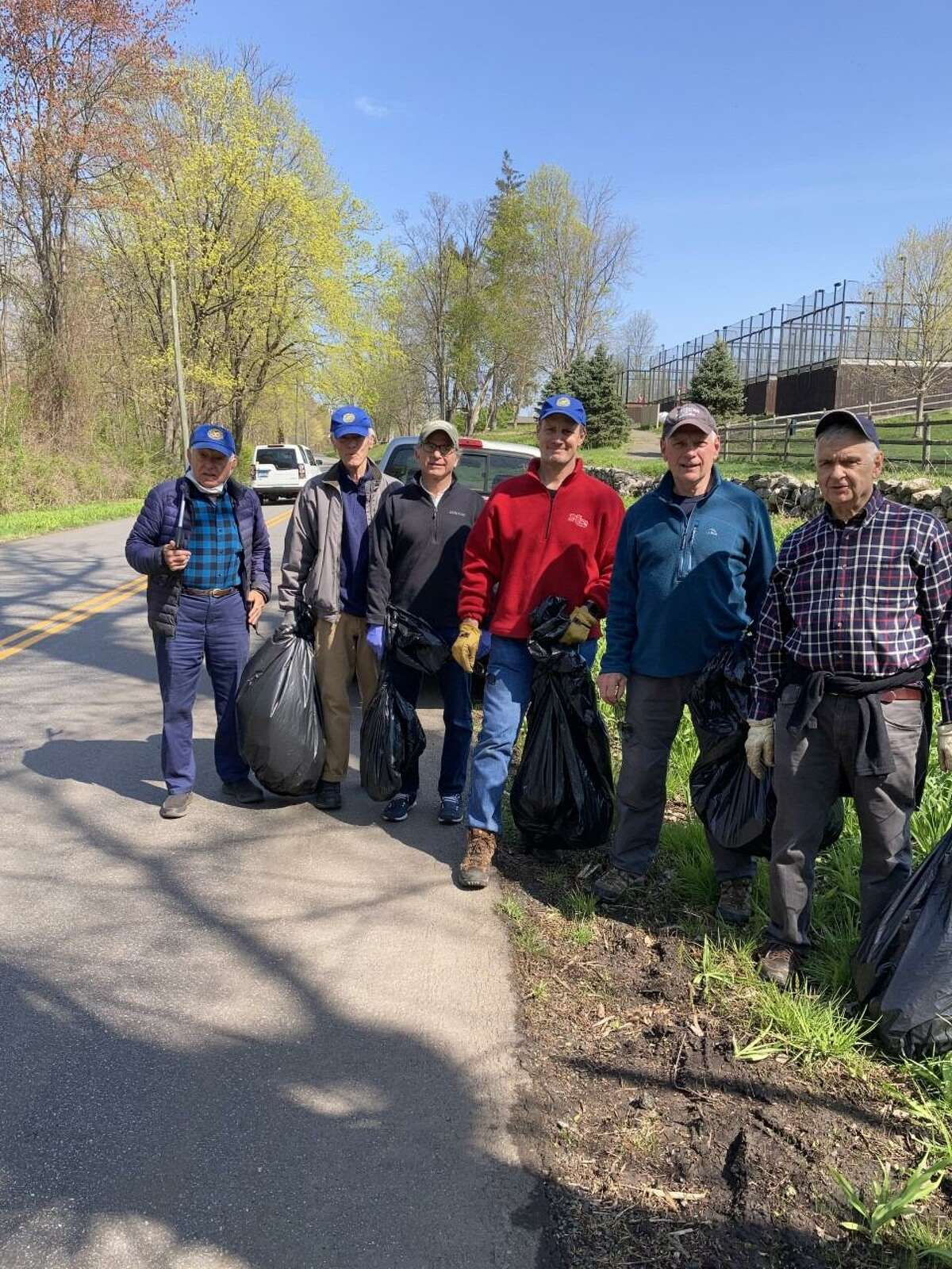 Members of the New Canaan Exchange Club, and families worked to pick up and dispose of trash on Lapham Road on the west side of Waveny Park this past Saturday, April 24. A pickup truck full of refuse was removed from the roadside. Exchange Club members in this photo are: Gene Milosh, Bob Williams, Charles Taben, Steve Root, Mike Mimnaugh and Mike Gregorio. Luke Tashjian organized this year's, 2021, effort, and provided coffee, and donuts for the team.
