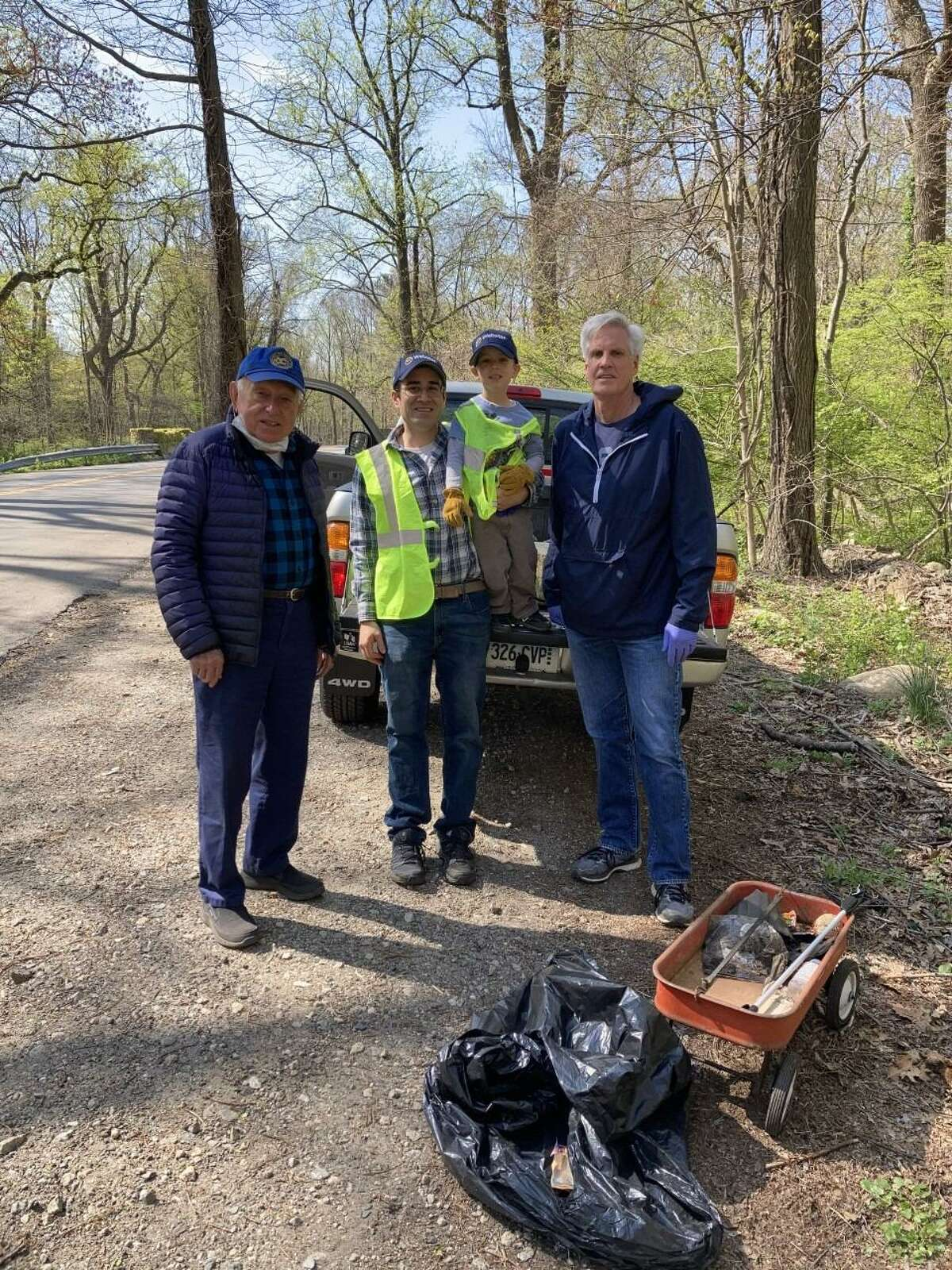 Members of the New Canaan Exchange Club and families worked to pick up and dispose of trash on Lapham Road on the west side of Waveny Park this past Saturday, April 24. A pickup truck full of refuse was removed from the roadside. Exchange Club members in this photo are: Gene Milosh, Luke Tashjian and son, and Tom Dunston. Luke Tashjian organized this year's, 2021, effort, and provided coffee and donuts for the team.