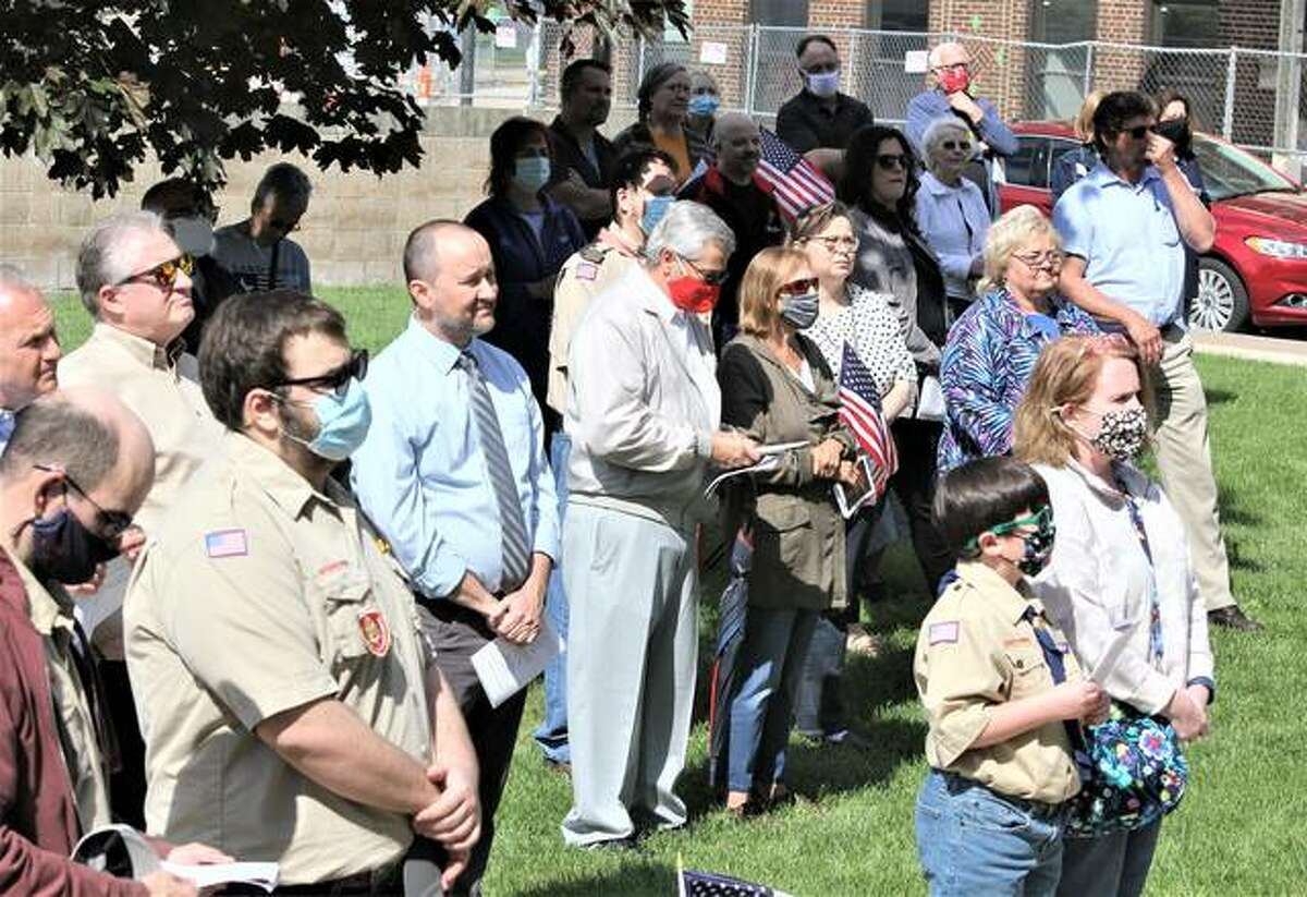 People watch and pray during National Day of Prayer observance at the Granite City Hall Thursday. The nationwide annual observance, which had been heavily curtailed last year because of COVID, was back this year with a variety of in-person and remote events. Local events include two live meetings in Granite City, another in Jerseyville, and a remote event in Alton.