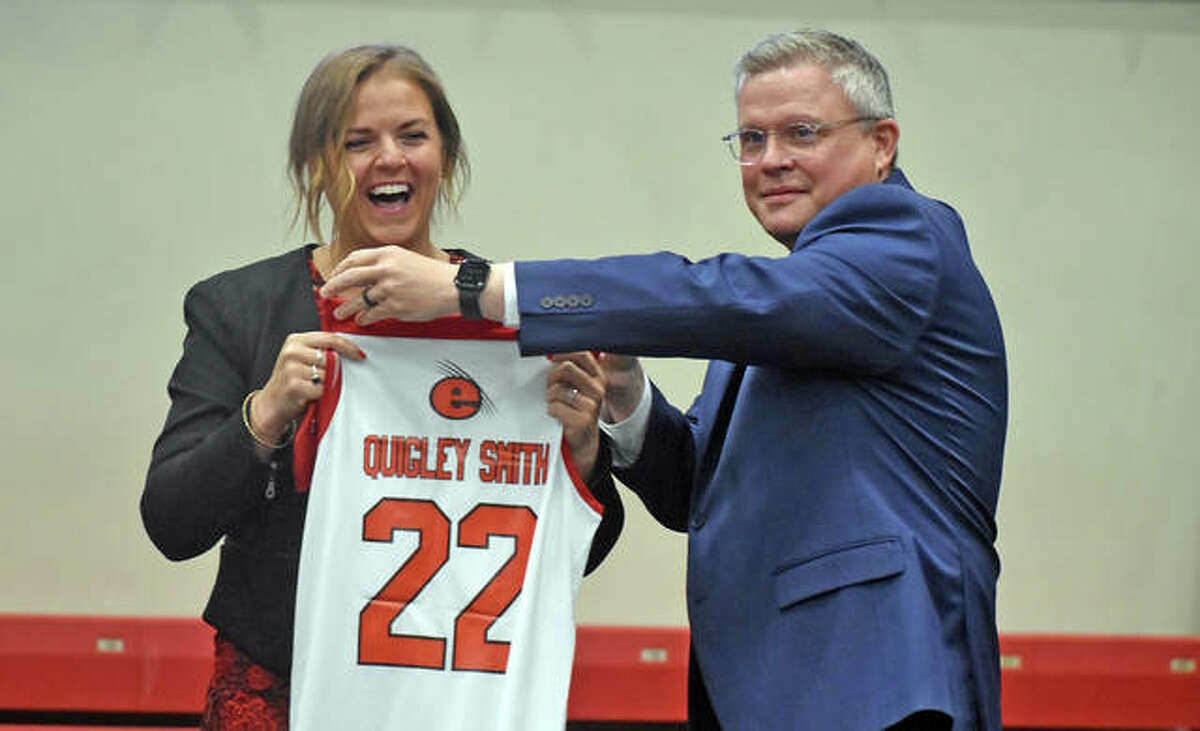SIUE athletic director Tim Hall presents new women's basketball coach Samantha Quigley Smith with a personalized jersey during Thursday's introduction inside First Community Arena.