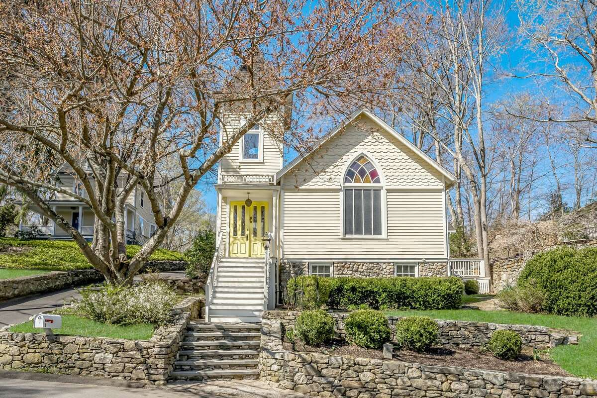 """Year built: 1890 3 bedrooms, 2 bathrooms, 2,382 square feet Price: $865,000 Before becoming a single-family home, this 131-year-old property had a previous life as a Swedish church. Now on the State Register of Historical Places, the home has an """"oversized open living area with cathedral ceilings, exposed beams and a magnificent stained glass window,"""" according to the listing. Those aren't the home's only church-like features: the master bedroom is situated in the Apse of the church, the listing notes, while a reading nook on the first floor is located in the bell tower. View listing"""