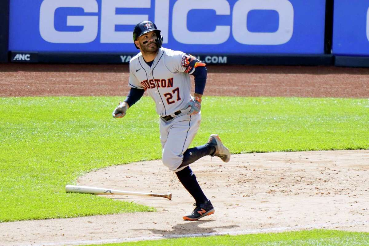 Houston Astros' Jose Altuve (27) watches his eighth-inning, three-run, home run as he trots the base path in a baseball game against the New York Yankees, Thursday, May 6, 2021, at Yankee Stadium in New York. (AP Photo/Kathy Willens)