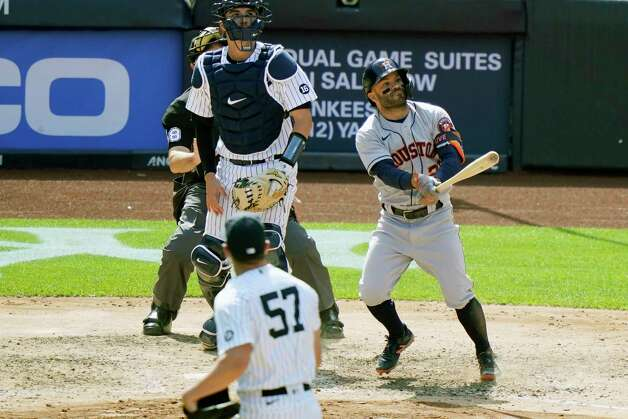 Houston Astros' Jose Altuve, New York Yankees relief pitcher Chad Green (57) and Yankees catcher Kyle Higashioka watch Altuvé's eighth-inning, three-run, home run, off Green, in a baseball game, Thursday, May 6, 2021, at Yankee Stadium in New York. (AP Photo/Kathy Willens) Photo: Kathy Willens, Associated Press / Copyright 2021 The Associated Press. All rights reserved.