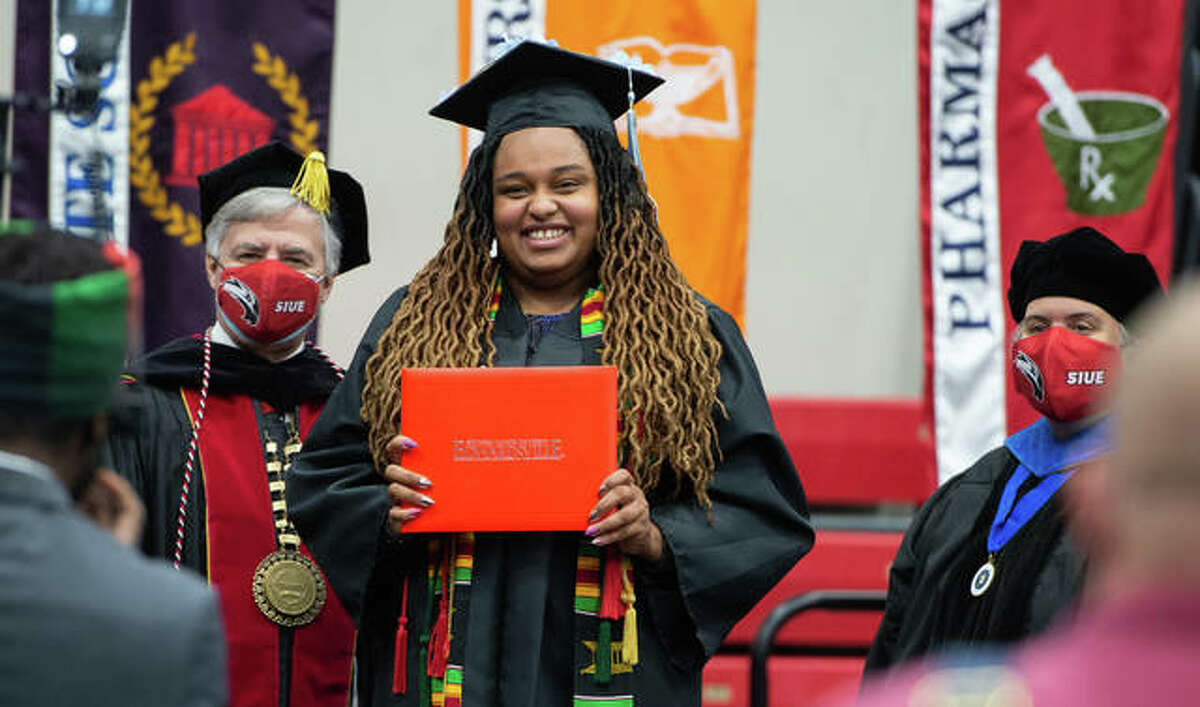 SIUE Chancellor Randy Pembrook, left, greets alumna Tatyana Curtis with Provost and Vice Chancellor for Academic Affairs Denise Cobb in a celebration of 2020 graduates who were unable to celebrate in-person during spring and fall 2020 because of the COVID-19 pandemic. Commencement exercises continue through Sunday.