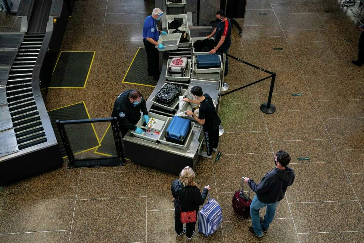 Travelers pass through security screening at Seattle-Tacoma International Airport on November 29, 2020 in SeaTac, Washington.