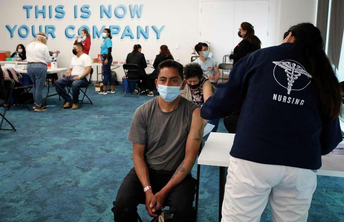 Marco Antonio Vega receives a vaccination at the Facebook headquarters vaccine distribution center in Menlo Park.