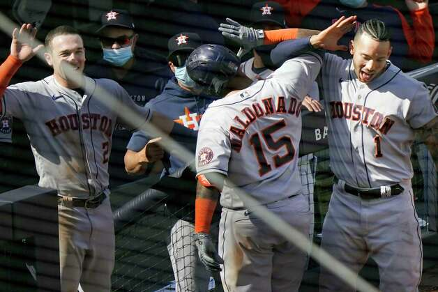 Houston Astros' Martin Maldonado (15) celebrates with teammates Carlos Correa (1) and Alex Bregman (2) after hitting a two-run home run during the ninth inning of a baseball game against the New York Yankees, Thursday, May 6, 2021, at Yankee Stadium in New York. (AP Photo/Kathy Willens) Photo: Kathy Willens, Associated Press / Copyright 2021 The Associated Press. All rights reserved.