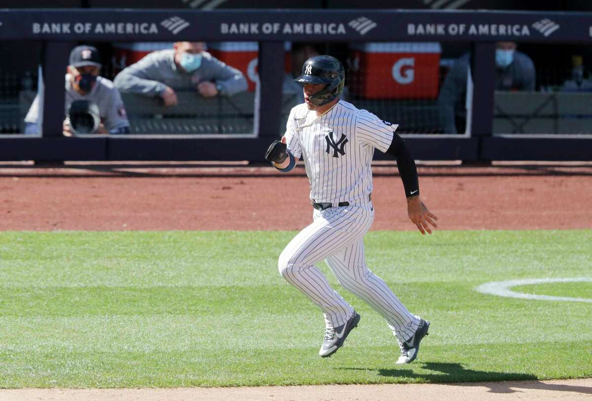 The Yankees' Gleyber Torres races home to score during the eighth inning to complete a bizarre play on which he came around from first base on an infield single against the Astros.